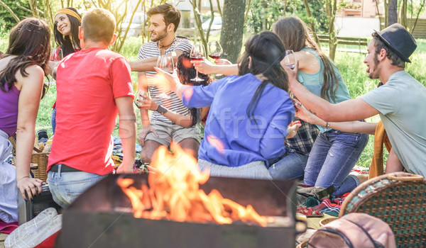 Stock photo: Happy friends making pic-nic with barbecue on city park outdoor