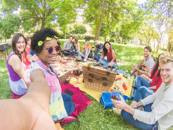 Happy afro woman taking selfie at picnic outdoor with her friend Stock photo © DisobeyArt