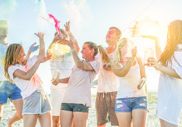 Happy friends partying with colorful powder cloud at holi festiv Stock photo © DisobeyArt