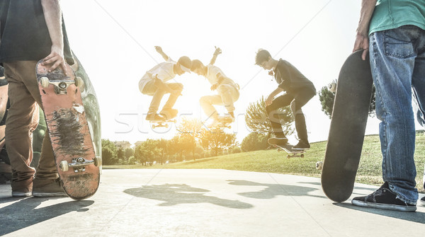 Stock photo: Young skaters jumping with skateboard in city suburb park - Spor