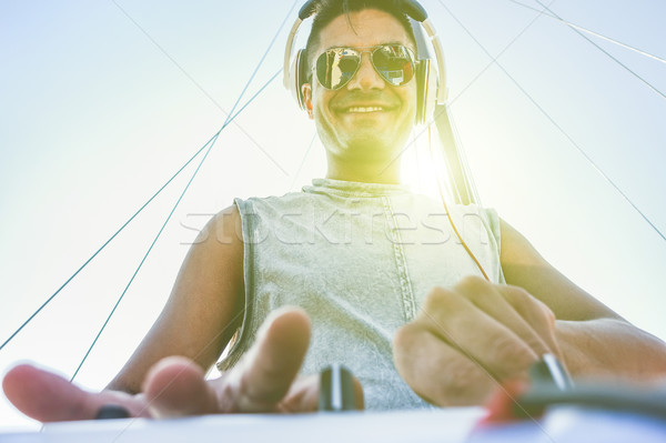 Cheerful dj mixing outdoor in boat party with back lighting in s Stock photo © DisobeyArt