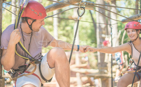 Couple of climbers having fun in adventure natural park outdoor  Stock photo © DisobeyArt