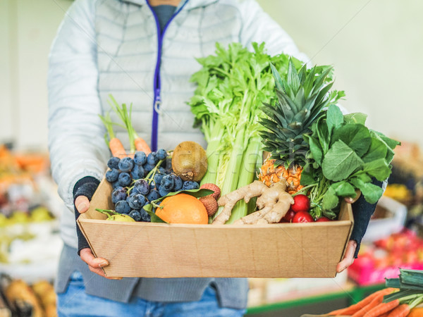 фрукты продавец женщину различный плодов овощей Сток-фото © DisobeyArt