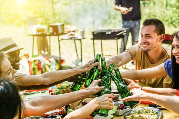 Cultura amici barbecue cena outdoor Foto d'archivio © DisobeyArt