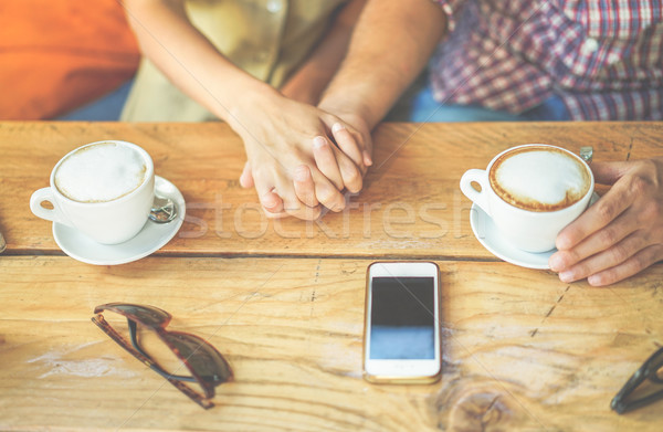Young couple toasting coffee cappuccino at bar cafeteria shop -  Stock photo © DisobeyArt