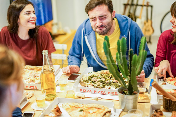 Young friends eating italian pizza take away at home - Happy stu Stock photo © DisobeyArt