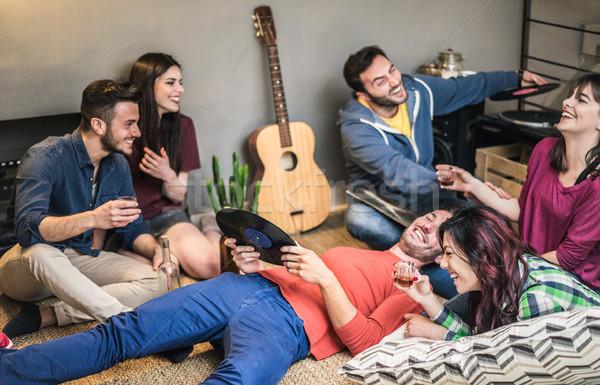 Happy friends having party listening vintage vinyl disc albums i Stock photo © DisobeyArt