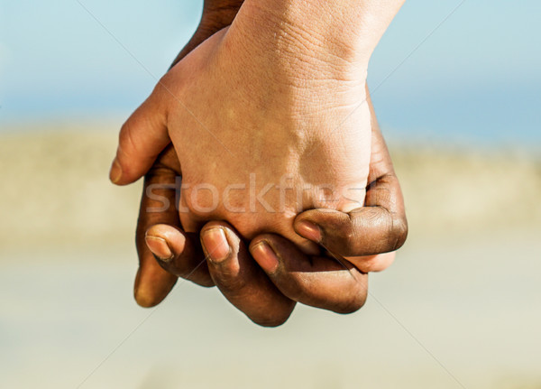 Diverse culture and race couple hands in love romantic moments o Stock photo © DisobeyArt