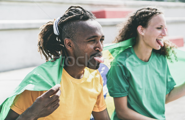 Two brazilian sport fans celebrating their country - Multiracial Stock photo © DisobeyArt
