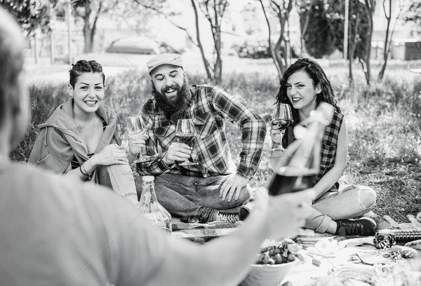 Happy friends making picnic on city park outdoor - Young hipster Stock photo © DisobeyArt