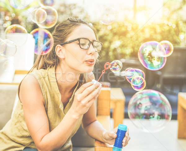 Młodych przystojny kobieta bańka mydlana miasta Zdjęcia stock © DisobeyArt