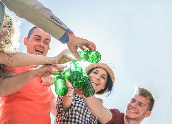 Mutlu arkadaşlar bira şişeler parti Stok fotoğraf © DisobeyArt