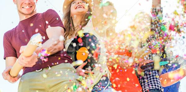 Grup mutlu arkadaşlar parti Stok fotoğraf © DisobeyArt