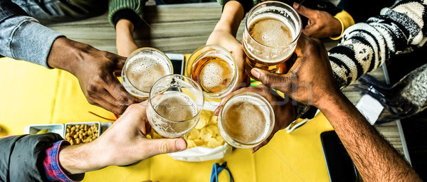 Top view of friends cheering with home brew in pub bar restauran Stock photo © DisobeyArt