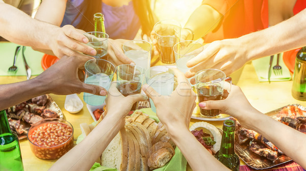 Group of friends toasting with aperitif eating barbecue outdoor  Stock photo © DisobeyArt