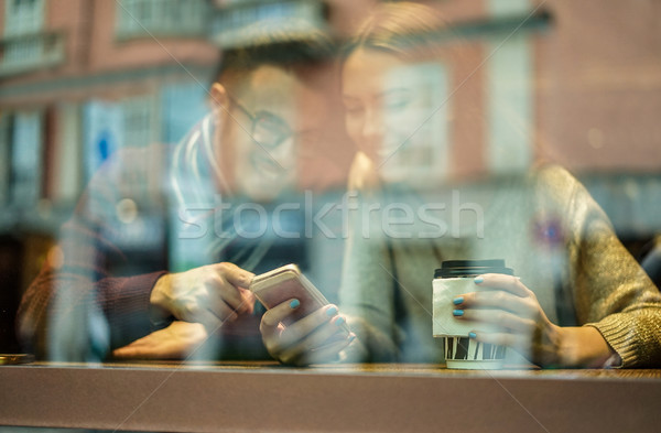 Young happy couple in coffee bar drinking cappuccino and having  Stock photo © DisobeyArt