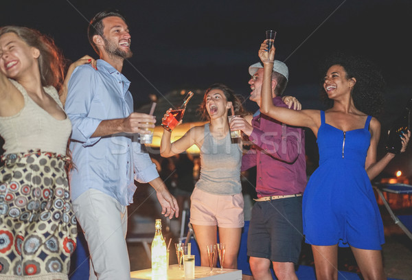 Stock photo: Happy friends celebrating at beach party outdoor drinking champa