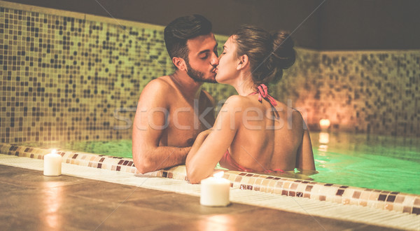 Lovers całując spa basen romantyczny Zdjęcia stock © DisobeyArt