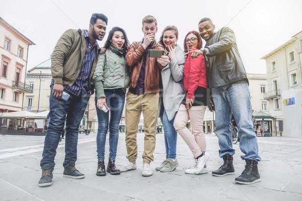 Grup insanlar bakıyor şaşırmış genç Stok fotoğraf © DisobeyArt