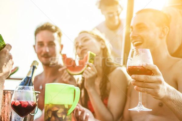 Mutlu arkadaşlar içme şarap yeme karpuz Stok fotoğraf © DisobeyArt