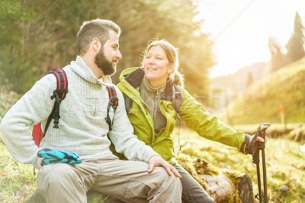 Young couple having a break after trekking in switzerland mounta Stock photo © DisobeyArt