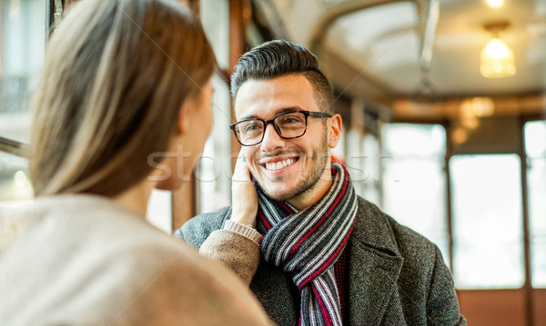 Young couple having tender moments inside old style tram bus - G Stock photo © DisobeyArt