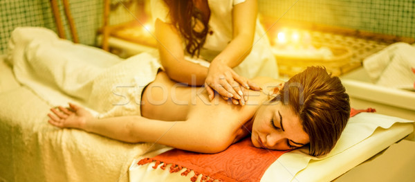 Young woman having back therapy massage in spa resort hotel salo Stock photo © DisobeyArt