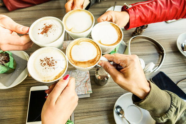 Stock photo: Friends group toasting cappuccino and milk with cocoa - Close up