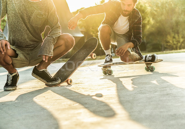 Stock photo: Young skaters performing with skateboard at sunset in urban city
