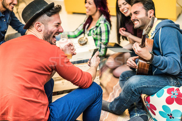 Group of trendy friends having fun in home living room - Happy y Stock photo © DisobeyArt