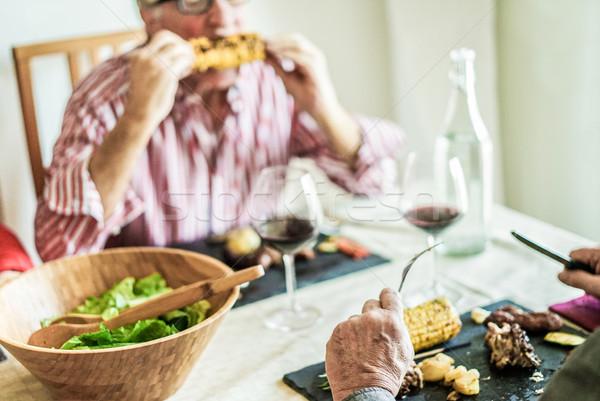 Idős barátok barbecue ebéd otthon idős emberek Stock fotó © DisobeyArt