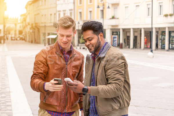 Best multiracial friends having fun with smartphones - Young peo Stock photo © DisobeyArt
