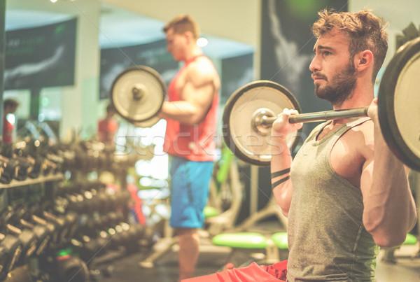 Arkadaşlar eğitim içinde amerikan spor salonu Stok fotoğraf © DisobeyArt