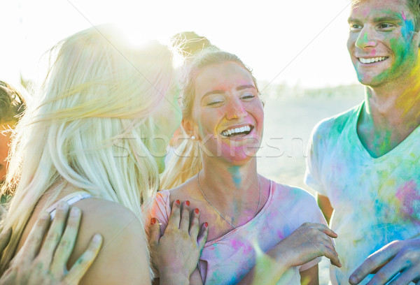 Happy friends enjoying party with powders holi colors at summer  Stock photo © DisobeyArt
