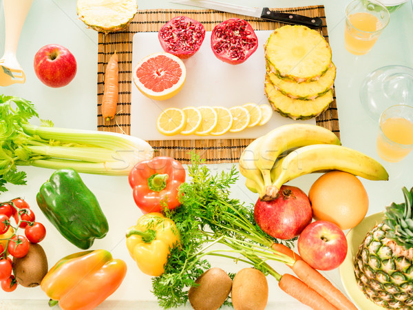 Composition with bio organic vegetables and fruits - Kitchen tab Stock photo © DisobeyArt