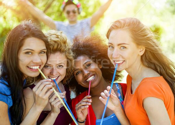 Mutlu etnik arkadaşlar içme kokteyl Stok fotoğraf © DisobeyArt