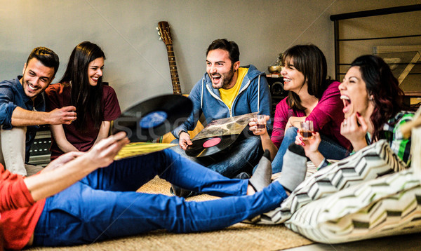 Happy friends having party listening vintage vinyl disc albums a Stock photo © DisobeyArt
