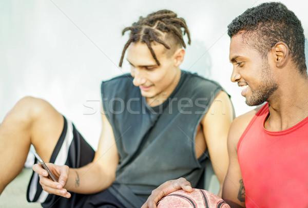 Mutlu arkadaşlar rahatlatıcı basketbol eğitim Stok fotoğraf © DisobeyArt