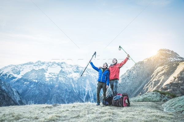 Hiker friends having reached peak of the mountain - Happy men ar Stock photo © DisobeyArt