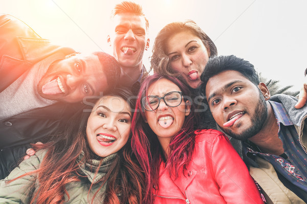 Cheerful friends from different countries and races taking selfi Stock photo © DisobeyArt