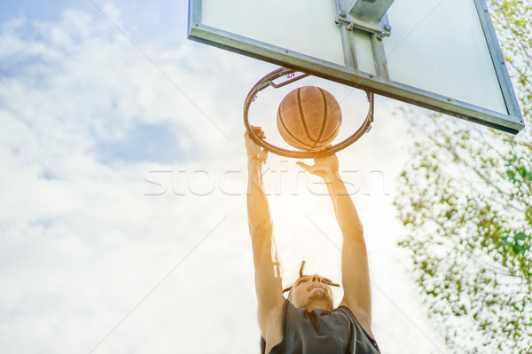 Young rasta basketball player dunking in urban grunge city camp  Stock photo © DisobeyArt