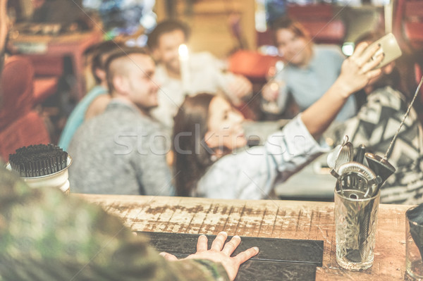 Barman view of happy friends taking selfie with mobile smart pho Stock photo © DisobeyArt