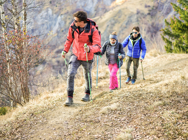Tour scout guide bringing young couple for trekking excursion -  Stock photo © DisobeyArt