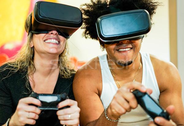 Diverso cultura Pareja jugando videojuegos Foto stock © DisobeyArt