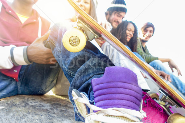 Group of happy friends having fun outdoor in urban city park wit Stock photo © DisobeyArt