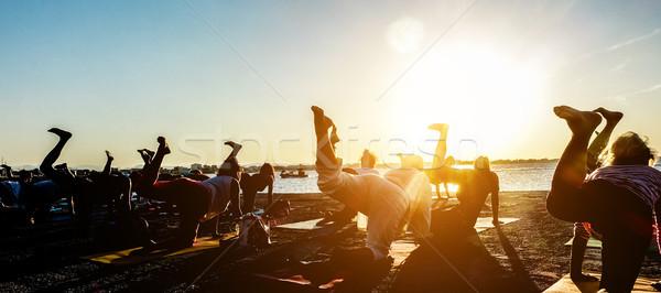 Siluet kadın yoga açık grup insanlar meditasyon Stok fotoğraf © DisobeyArt
