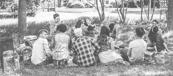 Group of friends making picnic with barbecue on city park outdoo Stock photo © DisobeyArt