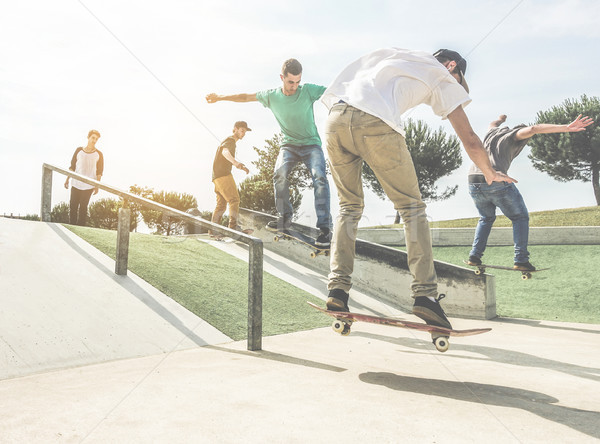 Group of skaters friends performing trick and skills in urban co Stock photo © DisobeyArt