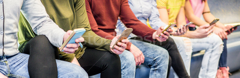 Group of people using mobile phones in metro subway underground  Stock photo © DisobeyArt