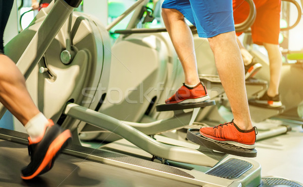 Group of people training on tapis roulant inside gym club - Fitn Stock photo © DisobeyArt